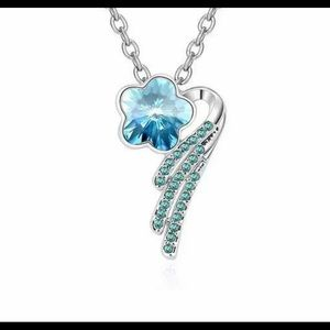 Jewelry - Silver necklace with blue shooting star pendant